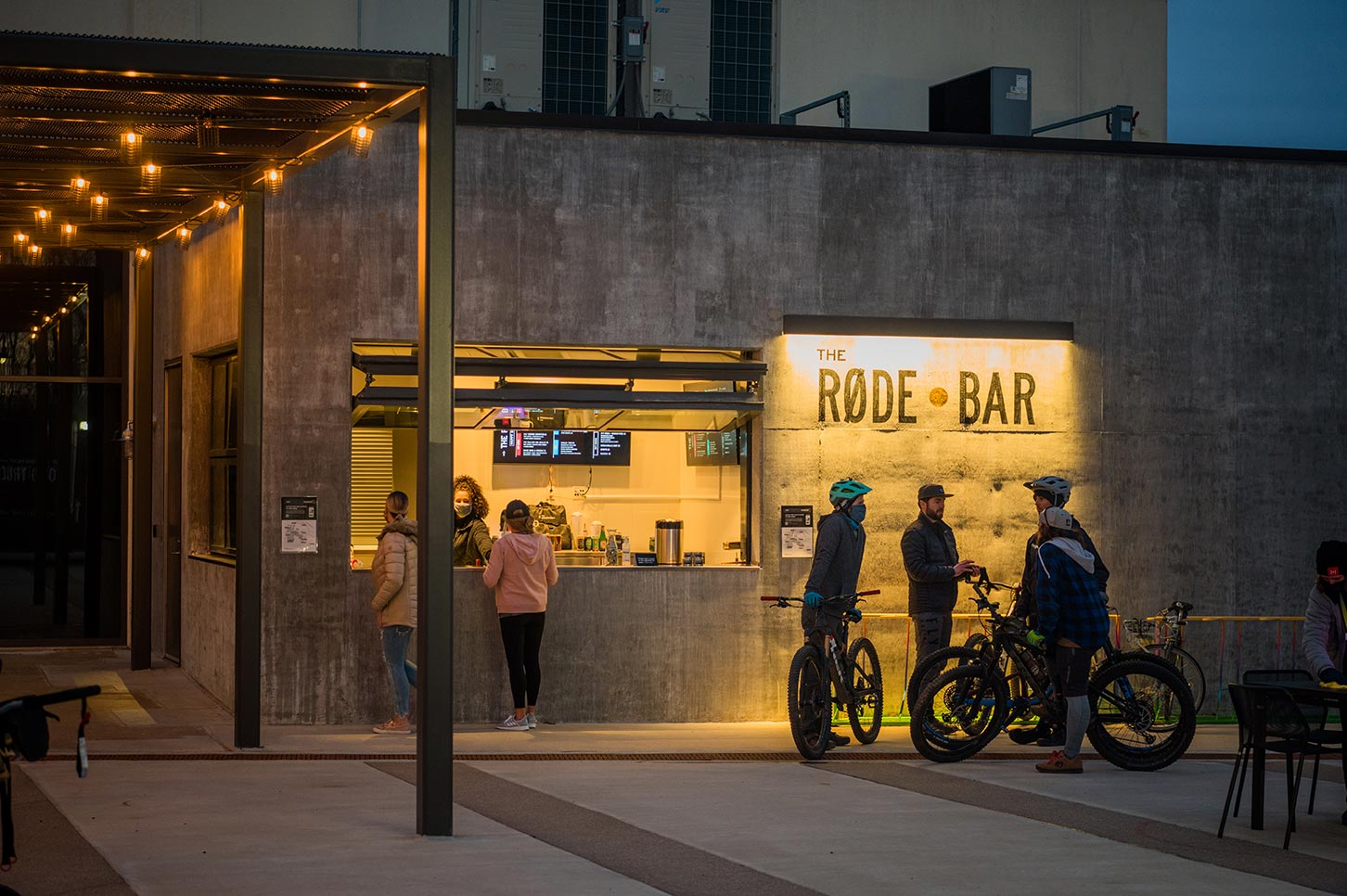 People outside of the RODE bar at dusk