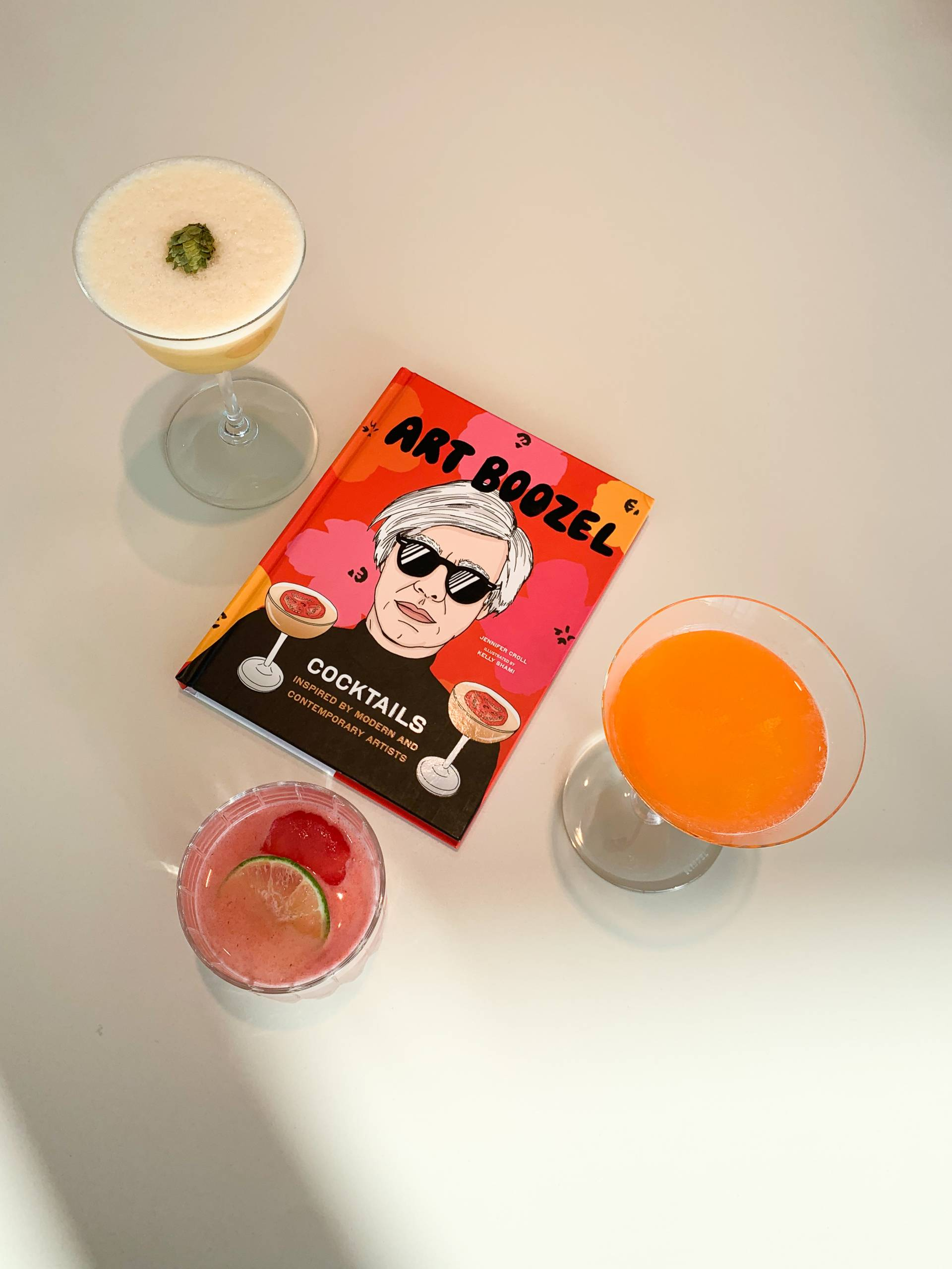 colorful cocktails with the book they are from called Art Boozel